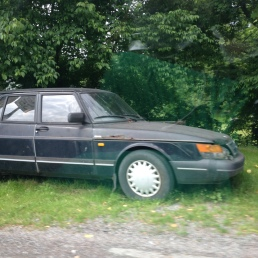 Old saab on side of the road